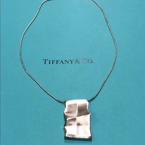 Authentic Tiffany & Co. Frank Gehry Fold Pendant.